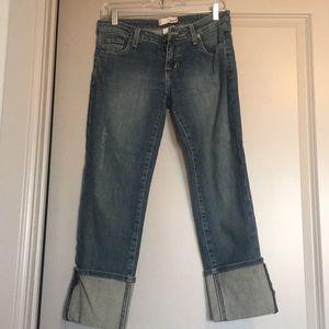 Medium wash Capri length jeans with cuffed bottom